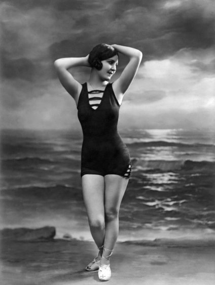 A pretty woman in a bathing suit poses in front of a studio ocean scene, Paris, France, circa 1920. (Photo by Underwood Archives/Getty Images)- thechicflaneuse