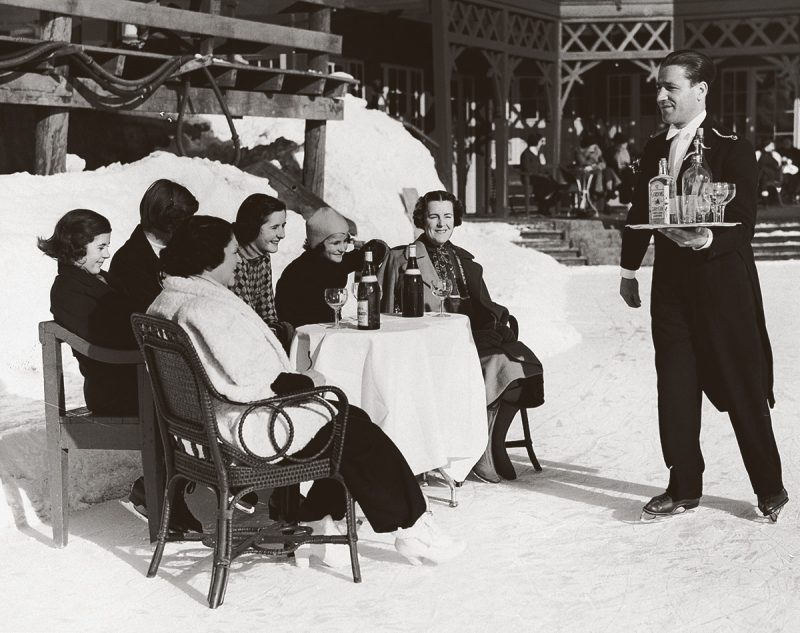An-ice-skating-waiter-in-St.-Moritz-Switzerland-delivers-gin-and-soda-to-British-ladies-1920s-Hulton-Deutsch-Collection-CORBIS-Corbis-via-Getty-Images