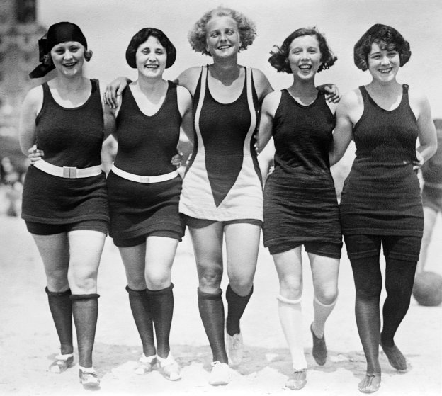 e arm-in-arm on the beach in their wool bathing suits; sepia-toned silver print, circa 1920s. (Photo by GraphicaArtis/Getty Images) - thechiflaneuse