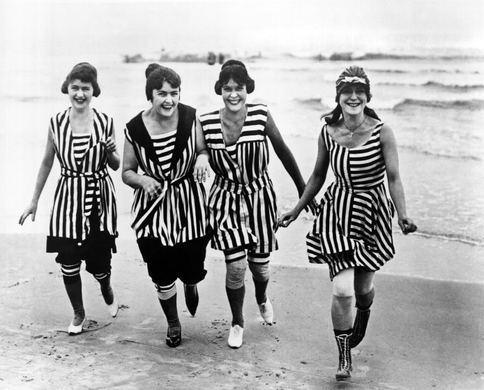Four young women in matching beach wear run out of the surf, Los Angeles, California, circa 1910. (Photo by Underwood Archives/Getty Images)