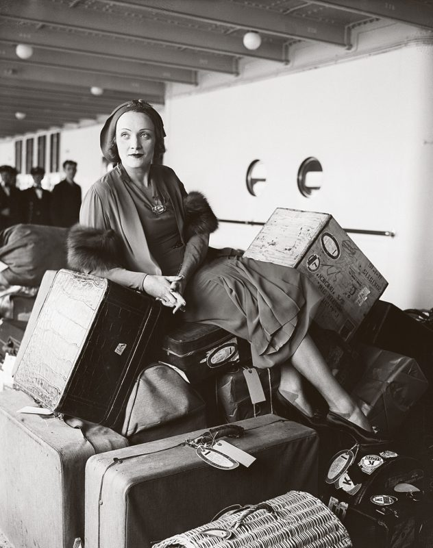 German-movie-star-Marlene-Dietrich-with-a-pile-of-luggage-en-route-to-the-USA-on-the-ocean-liner-Bremen-1931-Bettmann-Archive-Getty-Images