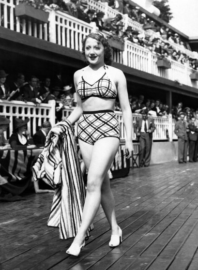 PARIS, FRANCE - CIRCA 1930: A model walks the runway during a swimsuit fashion show at the Molitor swimming pool, circa 1930 in Paris, France. (Photo by Keystone-France/Gamma-Rapho via Getty Images) - thechicflaneuse