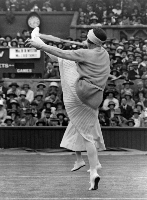 1924 French champion Suzanne Lenglen (1899 – 1938) playing at Wimbledon
