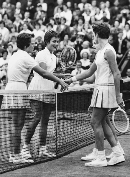 1961 Billie Jean King (left) and Karen Hantze Susman shaking hand to Jan Lehane O'Neill (right)