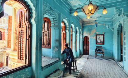 "Kuanglong Zhang Shenzhen, China 3rd Place, Photographer of the Year iPhone 7 The City Palace ""Udaipur is one of the most romantic cities in India. in the City palace, I snapped a moment of one of the staff gazing out of the window as if he saw the slowly historic course of the palace's construction, which was as quite attractive moment."""