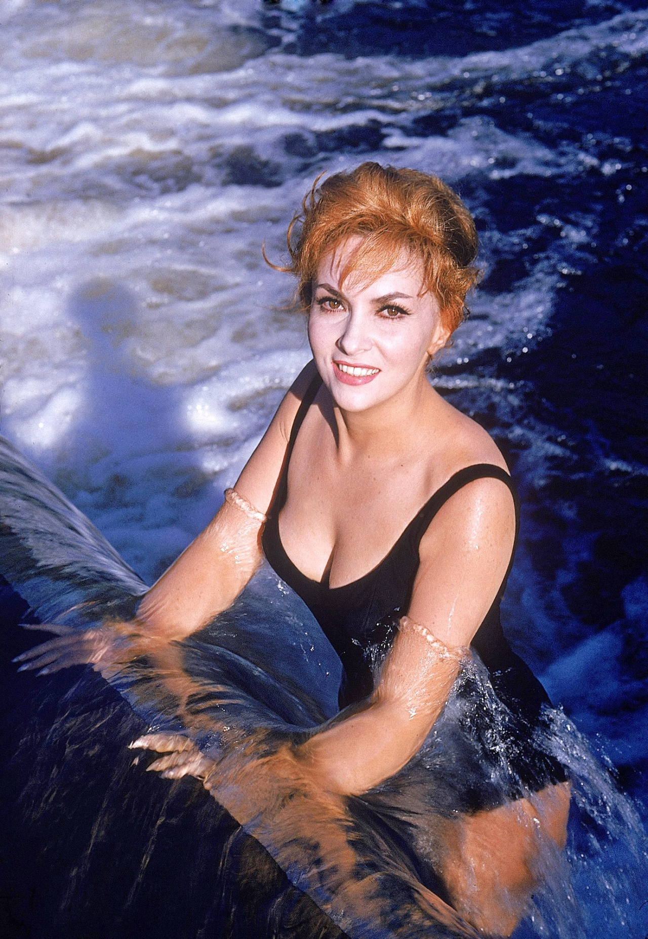 Gina Lollobrigida in a swimming pool. PETER STACKPOLE 1960