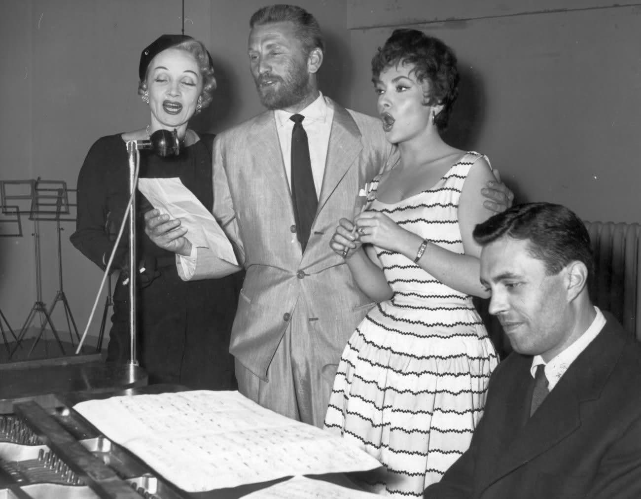 Marlene Dietrich, Kirk Douglas and Gina Lollobrigida at benefit's concert, Paris, 1955