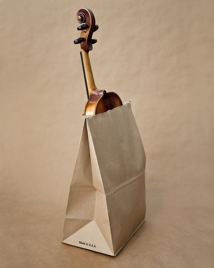 Olivia Locher I-fought-the-law-Utah violin in a brown bag