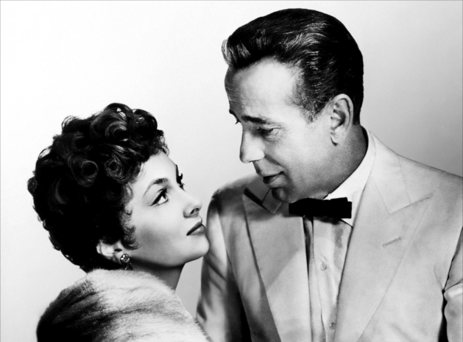 Portrait of Gina Lollobrigida and Humphrey Bogart for Beat the Devil directed by John Huston, 1953