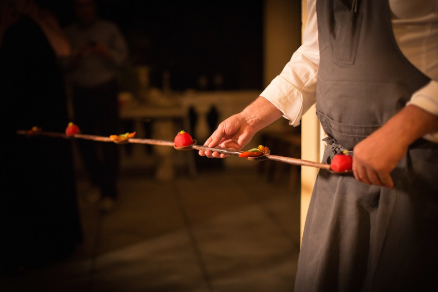 "Team of chef David Kinch (Manresa) serving ""Petit Farcis"" Pepper and Tomato on a sculptured walnut spoon by Julian Watts."