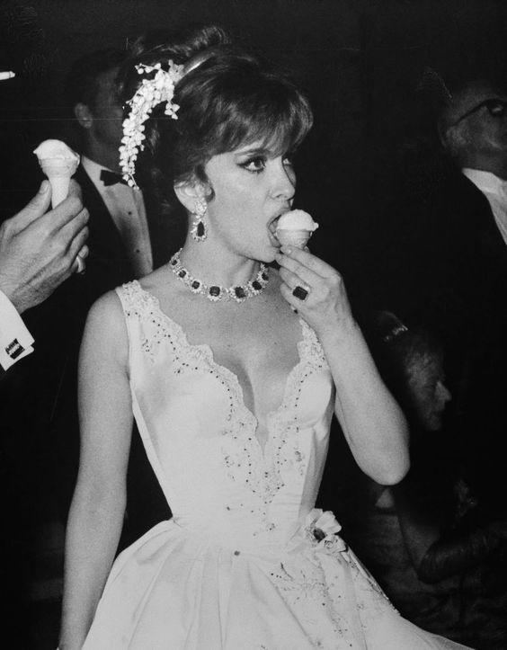 gina lollobrigida eating an ice-cream