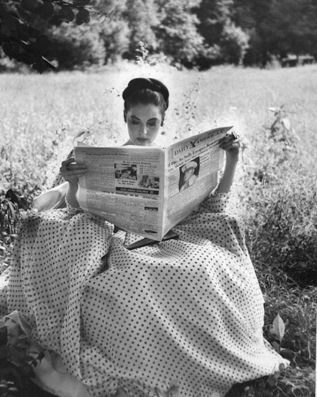 Ava Gardner reading in a garden